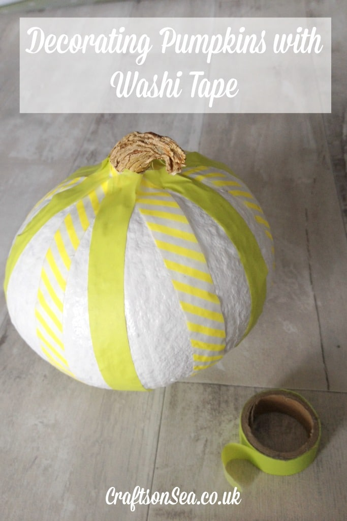decorating pumpkins with washi tape